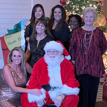 The Placentia team with Santa Claus